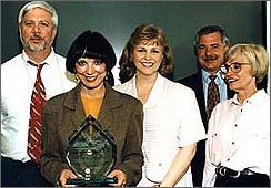 A picture of Nancy Foster getting an award