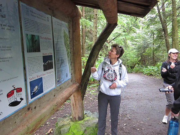 Carol Bernthal standing infront of a map of Cape Flattery
