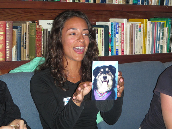 Tammy Silva holding a picture of a dog